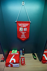 CARDIFF, WALES - Sunday, October 9, 2016: The Wales shirt of captain Ashley Williams and match pennant in the dressing room before the 2018 FIFA World Cup Qualifying Group D match against Georgia at the Cardiff City Stadium. (Pic by David Rawcliffe/Propaganda)