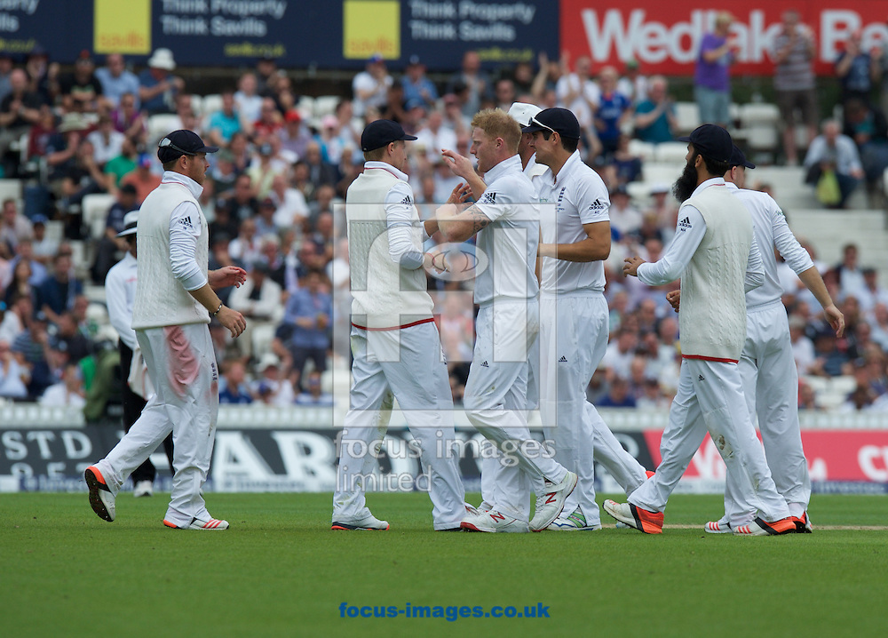 Ben Stokes of England (middle) is congratulated on taking the wicket of Captain Michael Clarke of Australia during the 5th Investec Ashes Test Match match at the Kia Oval, London<br /> Picture by Alan Stanford/Focus Images Ltd +44 7915 056117<br /> 20/08/2015