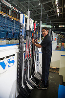 KELOWNA, CANADA - NOVEMBER 21: A volunteer bench staffer prepares the Kelowna Rockets' sticks for the game against the Portland Winterhawks on November 21, 2014 at Prospera Place in Kelowna, British Columbia, Canada.  (Photo by Marissa Baecker/Shoot the Breeze)  *** Local Caption *** bench; sticks;