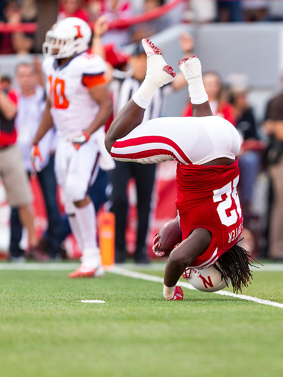 Trey Foster #42 of the Nebraska Cornhuskers flips over after catching a touchdown pass during Nebraska's game against Illinois at Memorial Stadium in Lincoln, Neb. on Oct. 1, 2016. Photo by Aaron Babcock, Hail Varsity