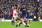 Milton Keynes Dons defender Callum Brittain (25) comes in to tackle Portsmouth defender Nathan Thompson (20) during the EFL Sky Bet League 1 match between Milton Keynes Dons and Portsmouth at stadium:mk, Milton Keynes, England on 10 February 2018. Picture by Dennis Goodwin.
