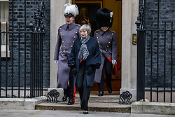 © Licensed to London News Pictures. 10/01/2019. London, UK. Prime Minister Theresa May (C) leaves 10 Downing Street as she prepares to meet Prime Minister of Japan Shinzo Abe. Photo credit: Rob Pinney/LNP