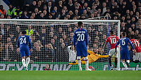 Football - 2019 / 2020 EFL Carabao (League) Cup - Fourth Round: Chelsea vs. Manchester United<br /> <br /> Wilfredo Caballero (Chelsea FC) guesses the wrong way from the Marcus Rashford (Manchester United) penalty as Manchester United take the lead at Stamford Bridge <br /> <br /> COLORSPORT/DANIEL BEARHAM