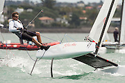 Simon McKeon (AUS958) rounds the top mark in race seven of the A Class World championships regatta being sailed at Takapuna in Auckland. 15/2/2014