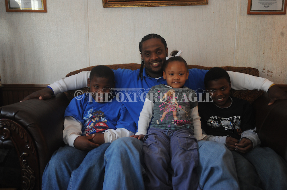 Jerry Pegues (second from l.) with (from l.) Jeremiah Pegues, JaKayla Pegues, and Rontavious Person in Oxford, Miss. on Wednesday, November 17, 2010.