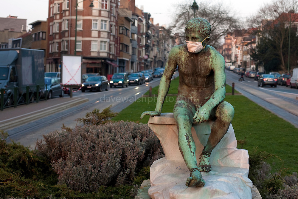 Statue wearing mask as protection against pollution, on Avenue du Parc, Brussels. This picture was made in March 2012. Mask places on statue by unknown person.