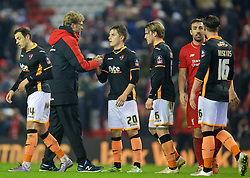LIVERPOOL, ENGLAND - Wednesday, January 20, 2016: Liverpool's manager Jürgen Klopp shakes hands with Exeter City's Tom Nichols after the 3-0 victory during the FA Cup 3rd Round Replay match at Anfield. (Pic by David Rawcliffe/Propaganda)