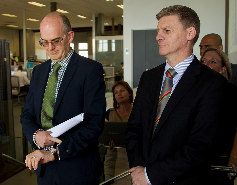 Minister of Finance Bill English, right, with Minister for State Owned Enterprises Tony Ryall watch the time during the visit to the NZX for Meridian Energy float in Wellington, New Zealand, Tuesday, October 29, 2013. Credit:SNPA / Marty Melville
