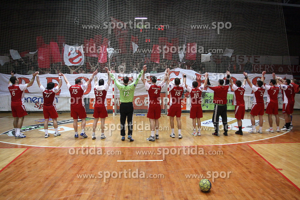 Players of Slovan with Fans Red Tigers when they celebrate 15 years of the group at 21st round of MIK 1st league handball match between RD Slovan and RK Prevent,  in Arena Kodeljevo, Ljubljana, Slovenia, on March 14, 2009.   (Photo by Vid Ponikvar / Sportida)