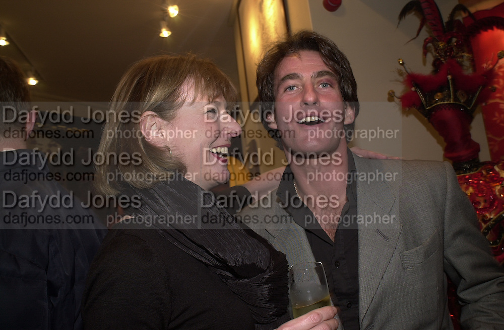 Julia Peyton-Jones and Tim Jeffries. Shanghai Tang opening. Sloane St. 11 April 2001. © Copyright Photograph by Dafydd Jones 66 Stockwell Park Rd. London SW9 0DA Tel 020 7733 0108 www.dafjones.com