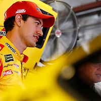 Joey Logano (22) hangs out in the garage during practice for the Consumers Energy 400 at Michigan International Speedway in Brooklyn, Michigan.
