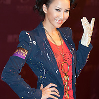 MACAU - FEBRUARY 01:  Singer Coco Lee poses for media wearing a copy of the famous white rhinestone glove worn by Michael Jackson at the 1983 Motown 25 Television Special during which he premiered the moonwalk to the world during the opening ceremony of the MJ Gallery at Ponte 16 Resort-Macau on February 1, 2010 in Macau.  Photo by Victor Fraile / studioEAST