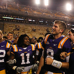 September 10, 2011; Baton Rouge, LA, USA;  LSU Tigers players linebacker Luke Muncie (52), running back Spencer Ware (11), quarterback Zach Mettenberger (8) and head coach Les Miles sing together with teammates following a win over the Northwestern State Demons at Tiger Stadium. LSU defeat Northwestern State 49-3. Mandatory Credit: Derick E. Hingle