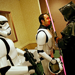Kyle Green | The Roanoke Times<br /> March 01, 2009 - Fitz Lewis (middle), and Zym Carroll, &quot;TK 3213&quot; (left), Stormtroopers in the Garrison Tyranus (Virginia) chapter of the 501st Legion, confront Alan Provo (right), dressed as Darth Maul from Star Wars, in a conference room at the Holiday Inn in Roanoke, Virginia during the 17th annual SheVaCon science fiction and fantasy convention. The 501st Legion, &quot;Vaders First&quot;, is &quot;The world's definitive imperial costuming organization&quot;. Virginia's Garrison Tyranus has 77 members, including Stormtroopers, Sith Lords, Denizens of the Empire, Imperial Officers, Bounty Hunters, Biker Scouts, Snowtroopers, Sandtroopers, and Tie Pilots.