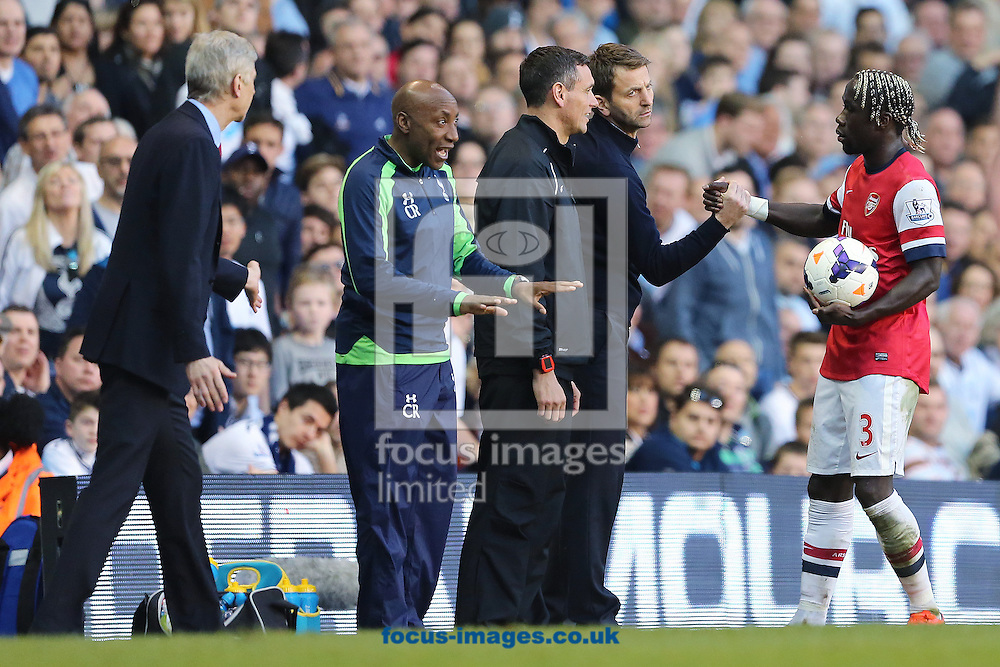 Manager of Tottenham Hotspur, Tim Sherwood shakes hands with Bacary Sagna of Arsenal after a flair up between the two during the  Barclays Premier League match from Tomas Rosicky (out of picture) at White Hart Lane, London<br /> Picture by Richard Calver/Focus Images Ltd +447792 981244<br /> 16/03/2014