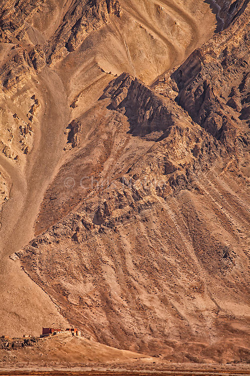 The Rangdum Monastery sits below desert Mountains on the way to Zanskar over the Penzi La (Pass).