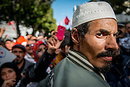 © Benjamin Girette / IP3 PRESS : February 16th, 2013:  Supporter of the Islamist ruling party Ennahda during a rally in Tunis. Activists from Tunisia's ruling Islamist party Ennahda denounce in a protest the plans for a government of technocrats to solve the country's crisis.