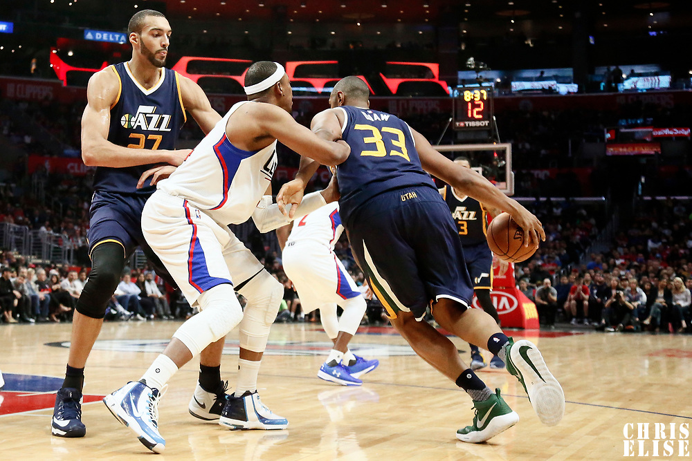 25 March 2016: Utah Jazz center Boris Diaw (33) drives past LA Clippers forward Paul Pierce (34) on a screen set by Utah Jazz center Rudy Gobert (27) during the Los Angeles Clippers 108-95 victory over the Utah Jazz, at the Staples Center, Los Angeles, California, USA.