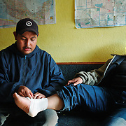A man give medical medical attention to a woman at a volunteer Migrant Center in Agua Perieta, Mexico on the United States Border near Douglas, Arizona. Both man and woman were caught by US border patrol after trying to cross illeagally. The Migrant Center does not encourage people to cross the nearly 2,000 mile border but will provide those who have been caught while crossing medical attention, as well as food and water. Hundreds of undocumented immigrants pass across the desert here, and dozens die every year from dehydration and exposure.