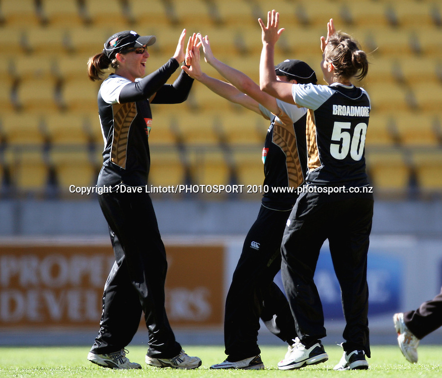 NZ's Katey Martin (centre) and bowler Kate Broadmore congratulate Maria Fahjey on running out Elysee Perry.<br /> Women's International Twenty20 cricket match - New Zealand White Ferns v Australia Southern Stars at Westpac Stadium, Wellington. Friday, 26 February 2010. Photo: Dave Lintott/PHOTOSPORT