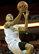 Jeremiah Jefferson (15) of Dallas Triple A Academy drives to the basket against Mumford during the UIL 1A division 1 state championship game at the Frank Erwin Center in Austin on Friday, March 8, 2013. (Cooper Neill/The Dallas Morning News)