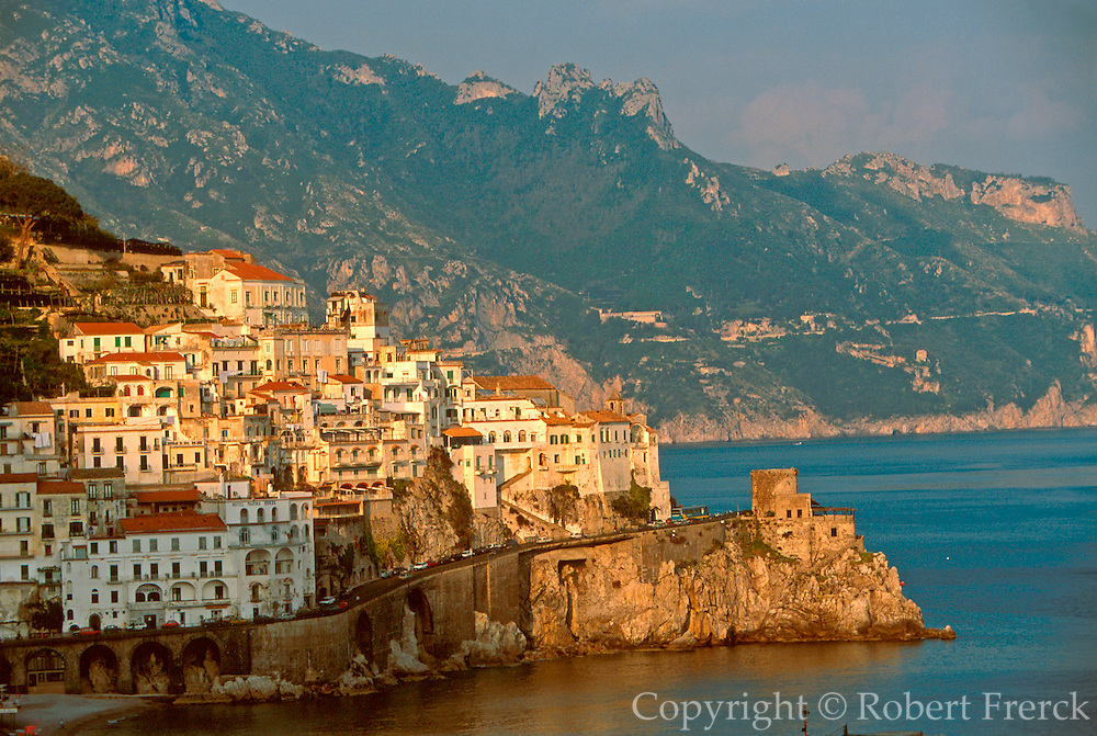 ITALY, AMALFI COAST, Amalfi, white homes and watchtowers rise above the harbor made famous as the 11thc. Maritime Republic of Amalfi