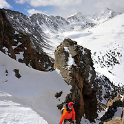 Ben Marshall works his way up a new route on McClellan Mountain in Colorado. The popular Fourteeners Grays and Torreys rise behind.