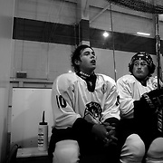 Two Minute Penalty… Kahu Joyce, (left) and Ethan Henare, New Zealand...Expressions in the penalty box of players serving a two minute penalty during the 2012 IIHF Ice Hockey World Championships Division 3 contested by New Zealand, Iceland, Bulgaria, Turkey and China at Dunedin Ice Stadium. Dunedin, Otago, New Zealand. January 2012. Photo Tim Clayton