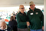 Dean Hugh Sherman poses for a portrait with Bruce Peterson at the College of Business tailgating party during homecoming weekend on Saturday, October 13, 2012..Photo by Chris Franz