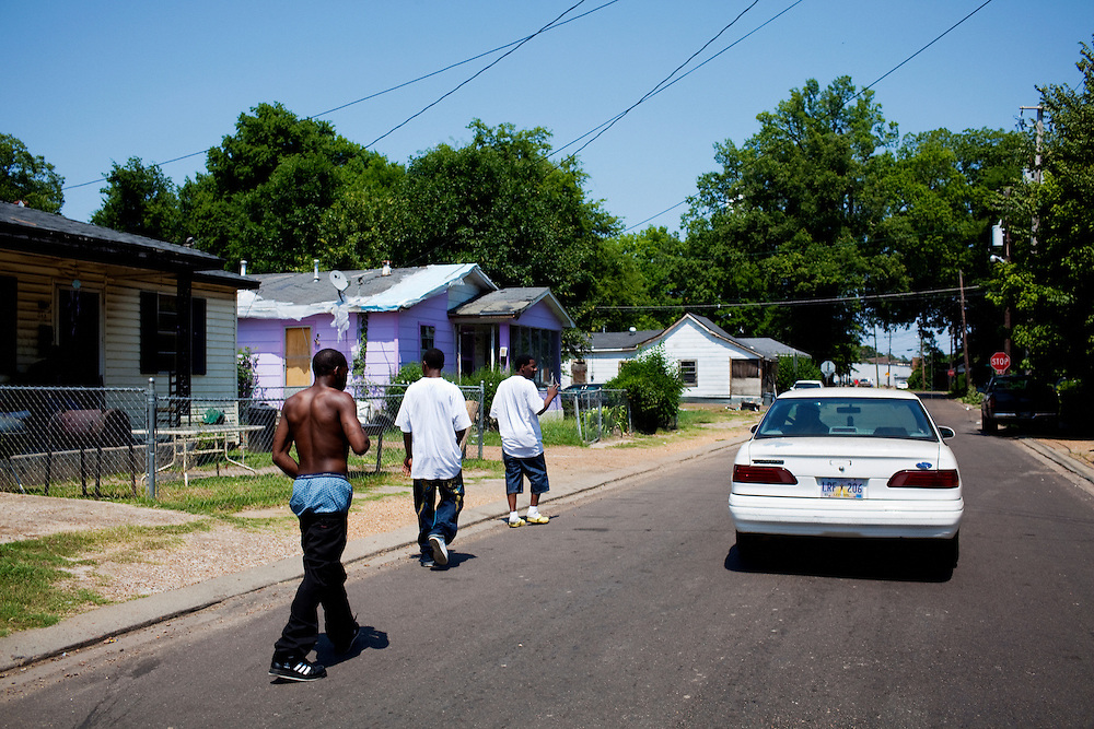 "Marvin Hall (aka ""12""), Robert Pritchett and Sean Williams walk down the street in the Baptist Town neighborhood of Greenwood, Mississippi on Saturday, July 3, 2010."