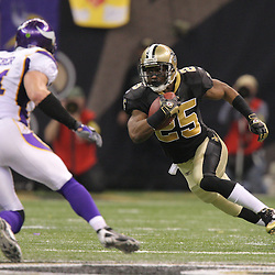 Jan 24, 2010; New Orleans, LA, USA; New Orleans Saints running back Reggie Bush (25) is pursued by Minnesota Vikings linebacker Ben Leber (51) during the second quarter of the 2010 NFC Championship game at the Louisiana Superdome. Mandatory Credit: Derick E. Hingle-US PRESSWIRE