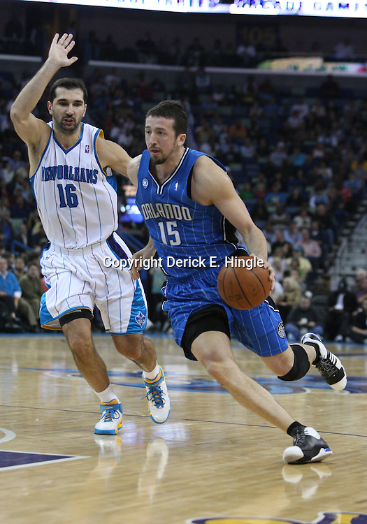 18 February 2009: Orlando Magic forward Hedo Turkoglu (15) drives past New Orleans Hornets forward Peja Stojakovic (16) during a NBA basketball game between the Orlando Magic and the New Orleans Hornets at the New Orleans Arena in New Orleans, Louisiana.