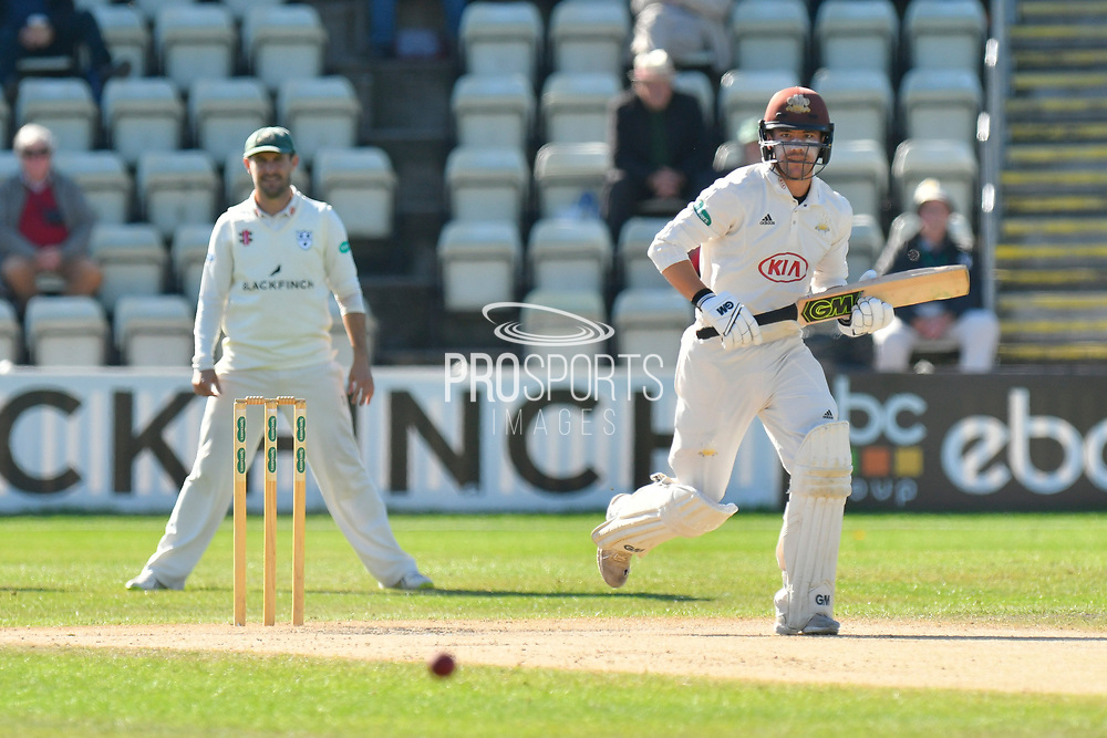 Rory Burns of Surrey hits the ball to the boundary for four runs during the final day of the Specsavers County Champ Div 1 match between Worcestershire County Cricket Club and Surrey County Cricket Club at New Road, Worcester, United Kingdom on 13 September 2018.