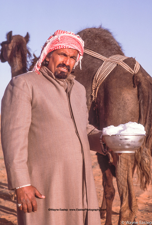 Rasid Sakhefan of the Al Marri with fresh camels milk in the eastern province of Saudi Arabia.