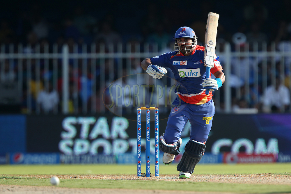 Murali Vijay of the Delhi Daredevils sets off during match 16 of the Pepsi Indian Premier League 2014 between the Delhi Daredevils and the Mumbai Indians held at the Sharjah Cricket Stadium, Sharjah, United Arab Emirates on the 27th April 2014<br /> <br /> Photo by Ron Gaunt / IPL / SPORTZPICS