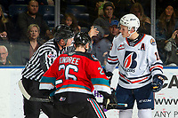 KELOWNA, BC - OCTOBER 12: Linesman Riley Balson calls for a new player for the face off against Liam Kindree #26 of the Kelowna Rockets as Connor Zary #18 of the Kamloops Blazers argues his position at Prospera Place on October 12, 2019 in Kelowna, Canada. (Photo by Marissa Baecker/Shoot the Breeze)