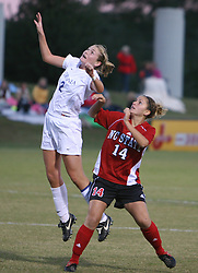 UVA's midfielder Jen Redmond (#2) goes up for a header against NC State's Kasie Shover (#14).  Redmond, who sang the national anthem before the game, scored one of UVA's two goals en route to a shutout over the Wolfpack.