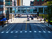 03 MAY 2017 - MINNEAPOLIS, MN: A pedestrian skyway crossing 3rd Ave in Minneapolis. The skyways are enclosed pedestrian overpasses that connect downtown buildings. The Minneapolis Skyway was started in the early 1960s as a response to covered shopping malls in the suburbs that were drawing shoppers out of the downtown area. The system grew sporadically until 1974, when the construction of the IDS Center and its center atrium, called the Crystal Court, served as a hub for the downtown skyway system. There are 8 miles of skyways, connecting most of the downtown buildings from Target Field (home of the Minnesota Twins) to US Bank Stadium (home of the Minnesota Vikings). In the last five years many upscale downtown apartment buildings and condominium developments have been added to the system, allowing downtown residents to live and work downtown without going outside.    PHOTO BY JACK KURTZ