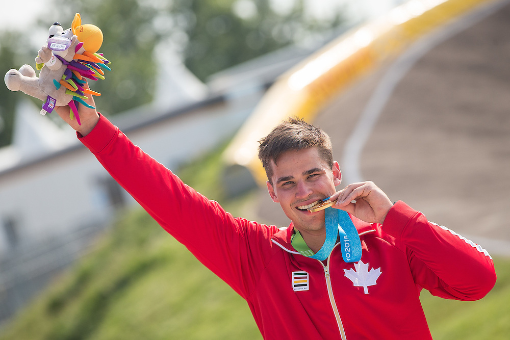 Gold medalist Tory Nyhaug of Canada celebrates his win in the BMX  during the medal ceremony at the 2015 Pan American Games in Toronto, Canada July 11,  2015.  AFP PHOTO/GEOFF ROBINS