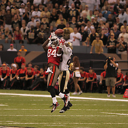 2008 September 7: New Orleans Saints cornerback Randall Gay (20) breaks up a pass intended for Tampa Bay Buccaneers wide receiver Joey Galloway (84) during the fourth quarter of their game at the Louisiana Superdome in New Orleans, LA.  The New Orleans Saints defeated the Tampa Bay Buccaneers 24-20.