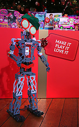 © Licensed to London News Pictures. 04/11/2015. London, UK. A Meccanoid Robot made by Maccano is shown at the Dream Toys Christmas event. Photo credit: Peter Macdiarmid/LNP