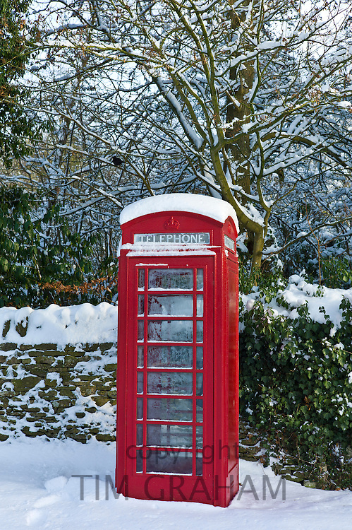 Traditional telephone box in the village of Swinbrook, The Cotwolds