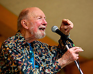 Pete Seeger performs at the 2012 Clearwater Festival in a concert with Arlo Guthrie and his family to celebrate the 100th birthday of Woody Guthrie. This photo originally appeared in Patch.com: http://rivertowns.patch.com/articles/clearwater-festival-2012