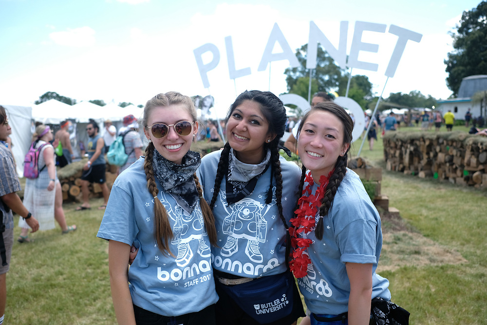 Three Bonnaroo volunteers pose for a photo during  The Bonnaroo Music and Arts Festival.