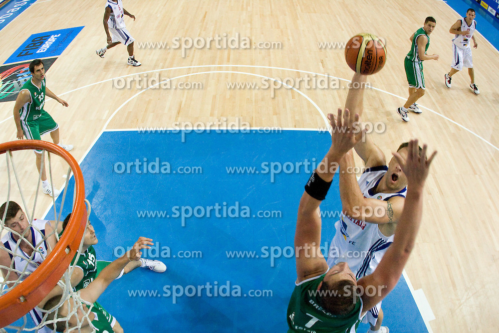 Primoz Brezec (7) of Slovenia vs Daniel Clark of Great Britain  during the basketball match at 1st Round of Eurobasket 2009 in Group C between Slovenia and Great Britain, on September 07, 2009 in Arena Torwar, Warsaw, Poland. (Photo by Vid Ponikvar / Sportida)