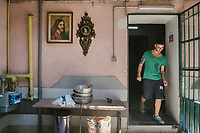NAPLES, ITALY - 13 JULY 2017: A worker is seen here at Antonio di Paola's Freselle bakery at Porta Capuana in Naples, Italy, on July 13th 2017.