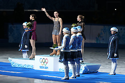 The XXII Winter Olympic Games 2014 in Sotchi, Olympics, Olympische Winterspiele Sotschi 2014<br /> Medalists in the women's figure skating competition at the XXII Olympic Winter Games in Sochi during the flower ceremony, silver medalist Kim Yuna (South Korea); gold medalist Adelina Sotnikova (Russia); bronze medalist Carolina Kostner (Italy).