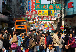 Pedestrians crossing street in Kowloon district of Hong Kong China