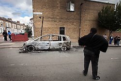 © Licensed to London News Pictures . 07/08/2011 . London , UK . A burned out car on Pembury Road in Tottenham . Overnight rioting and looting in Tottenham , following a protest against the police shooting of Mark Duggan . Photo credit : Joel Goodman/LNP