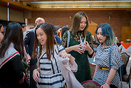 Reception for graduating students from China Agricultural University (CAU) students. The first class of graduates from CASNR/CAU in Agribusiness. Students involved in this program majored in Agricultural Economics both at CAU and OSU. CAU's joint degree programs enable students at CAU to enjoy choices of continuing their university study at other American universities.